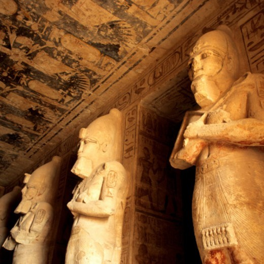 Stock Photo: 1598R-10082652 Great Temple of Rameses II, Abu Simbel, Aswan, Egypt.Travel Destinations, Temple, indoors, Sculpture, Old Ruin, Statue, Standing, Pharaoh, King, International Landmark, Stone, Art and Craft, Rameses II, Antiquities, Side By Side, Ancient Egyptian Culture, No People, Ancient Civilization, Male Likeness, Stone, Carving, Large, Famous Place, Ceiling, Hieroglyphics, Tomb, Sarcophagus,
