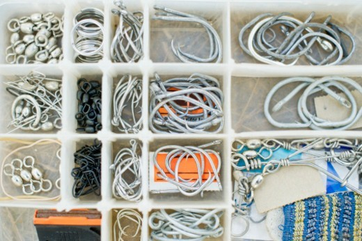 Stock Photo: 1598R-10082685 Multiple types of fishing hooks and lures are organized in a tackle box