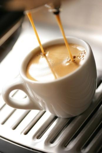 Espresso pouring into cup : Stock Photo