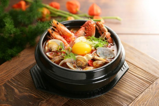 Korean food, Sundubujjigae with seafoods : Stock Photo