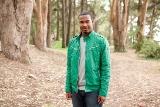 Portrait of a smiling young  man in the woods. : Stock Photo
