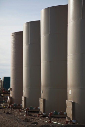 Storage tanks on an oil well location. : Stock Photo