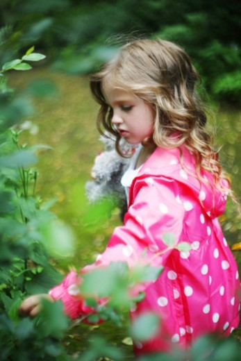 little girl in the garden : Stock Photo