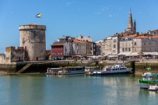 Stock Photo: 1598R-10084533 The port of La Rochelle on the coast of the Poitou-Charentes region of France. The tower is the Tour de la Chaine and dates from the 11th century.