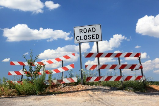 Road closed sign on a sunny day with clouds : Stock Photo