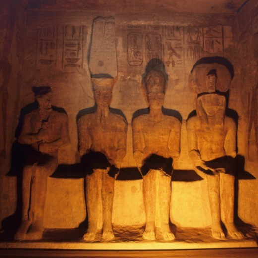 Stock Photo: 1598R-10086446 Temple in Abu Simbel -Aswan, Egypt.Rameses II, Temple, Pharaoh, Statue, sculpture, Stone, Ancient Egyptian Culture, Male Likeness, Female Likeness, Side By Side, Antiquities, International Landmark, Old Ruin, Travel Destinations, Ancient, Antiquities, Carving, Stone, Hieroglyphics, Famous Place, king, Queen, Tomb, Ancient Civilization, Sunlight, Shadow