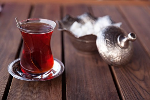 Stock Photo: 1598R-10087526 Turkish Tea with sugar pot in background