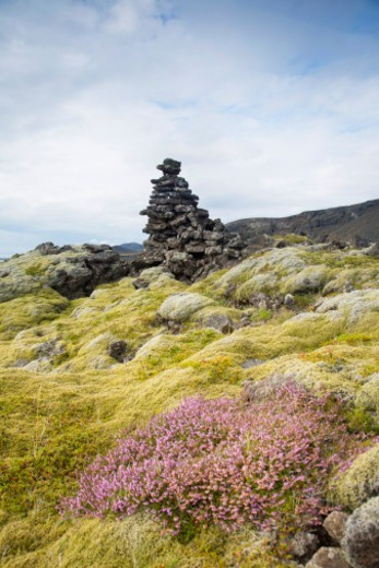 Stone marker cairn in mossy lava field on south coast. : Stock Photo