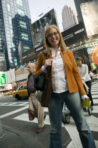 Woman crossing busy street, New York, USA : Stock Photo