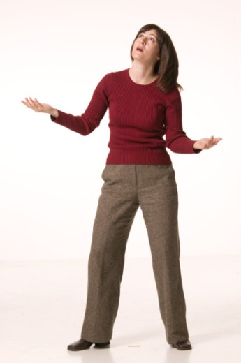 Woman standing with arms stretched, looking up : Stock Photo