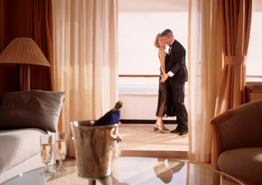 Stock Photo: 1598R-103511 Couple dancing in balcony at elegant party