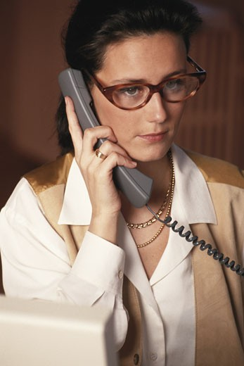 Business woman using telephone, close-up : Stock Photo