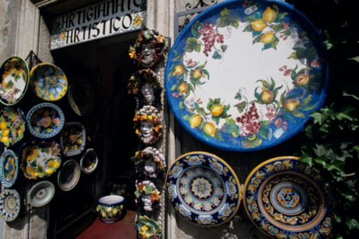 Ornamental plates hanging outside shop, Orvieto, Italy, close-up : Stock Photo