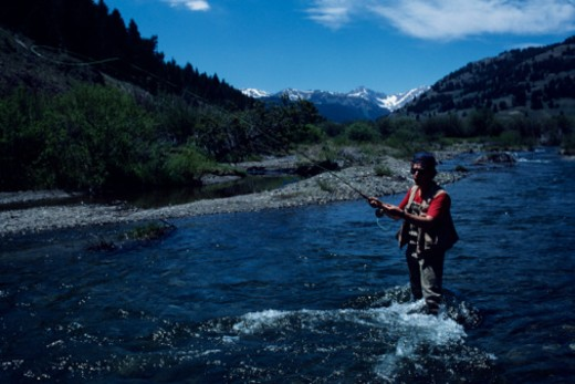 Stock Photo: 1598R-105622 Man fly fishing in river, elevated view