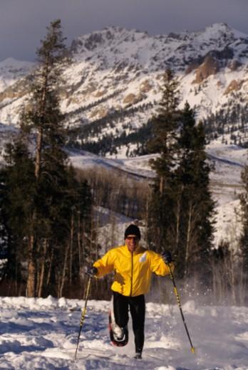 Man snowshoeing in mountains : Stock Photo
