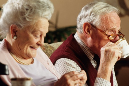 Stock Photo: 1598R-105849 Elderly couple on couch