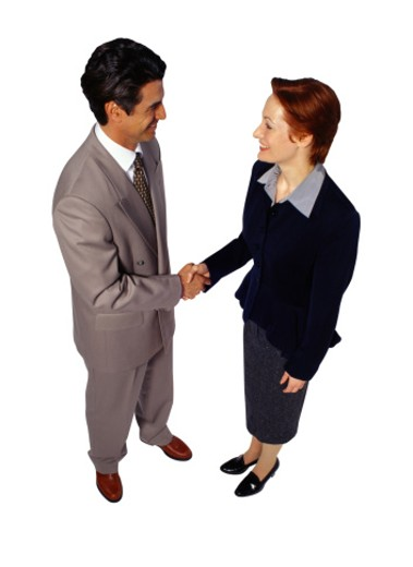 Stock Photo: 1598R-107524 Businessman and Businesswoman Shaking Hands