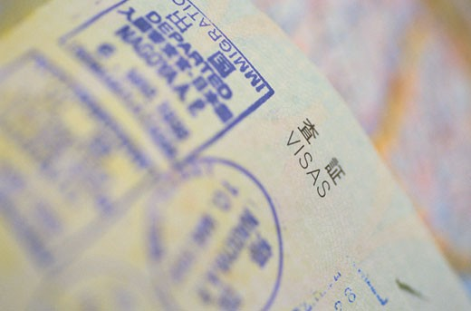 Detail of Visa Stamps in a Japanese Passport : Stock Photo