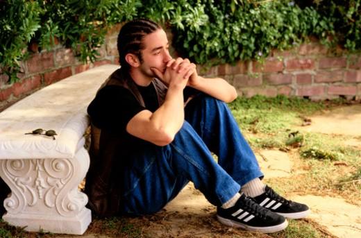 Teen Boy Thinking in a Garden : Stock Photo
