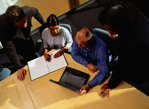 Above View of Businesspeople in a Meeting : Stock Photo