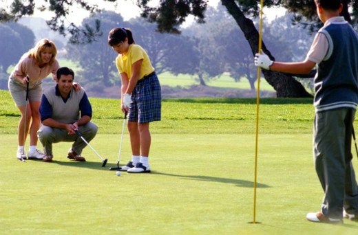 Stock Photo: 1598R-109547 Family Playing Golf