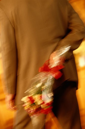 Stock Photo: 1598R-109773 Man with a Bouquet of Roses