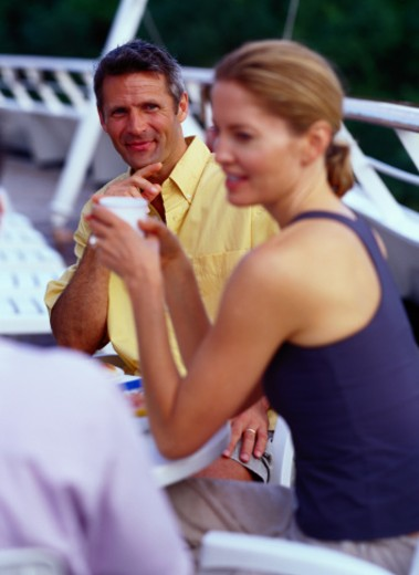 Three People Having a Meal on a Cruise Ship : Stock Photo
