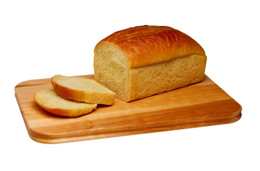 Stock Photo: 1598R-110301 Sliced Loaf of Bread on Wooden Cutting Board