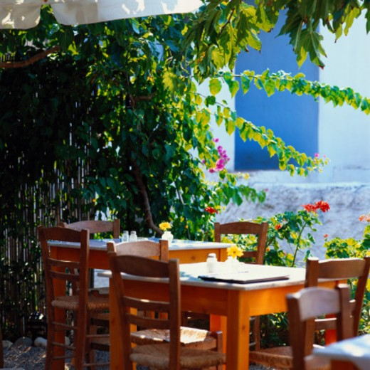 Stock Photo: 1598R-111009 Table and Chairs in Greek Restaurant, Stoupa
