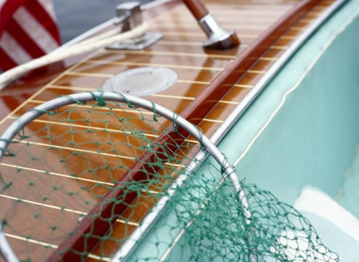 Fishing Net Resting on the Side of a Boat : Stock Photo