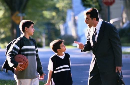 Stock Photo: 1598R-112408 Father Scolding His Two Sons