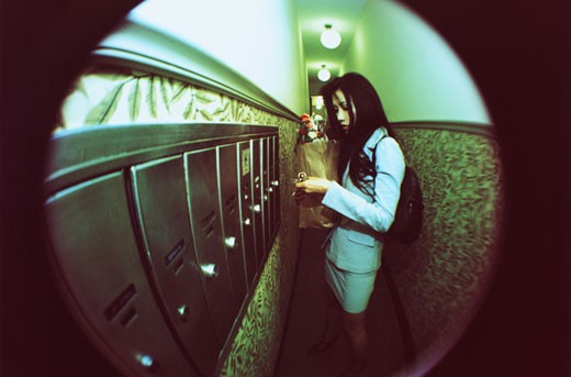 Stock Photo: 1598R-112506 Woman Through a Peephole