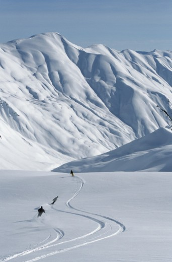 Skiers on a Powdery Slope : Stock Photo