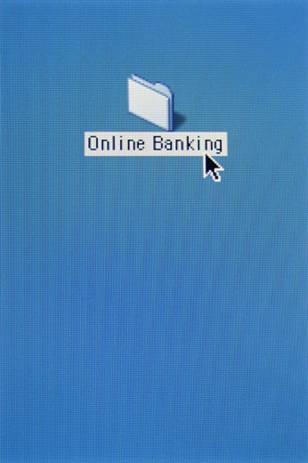 Stock Photo: 1598R-114226 Electronic file folder marked 'online banking' on computer desktop