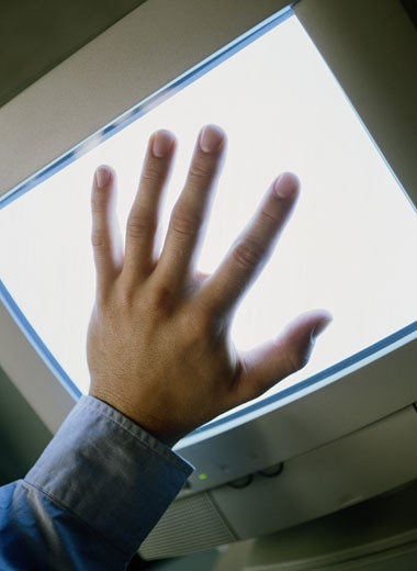 Hand Touching a Glowing Computer Monitor : Stock Photo