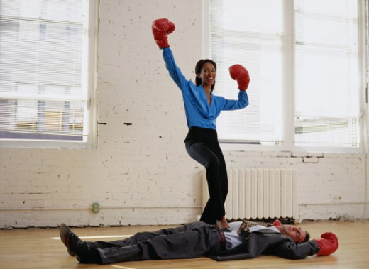 Businesswoman Celebrating Knocking Out an Opponent : Stock Photo