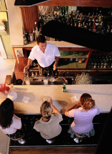 Stock Photo: 1598R-118762 Bartender and Bar