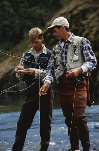 Men Fly Fishing : Stock Photo