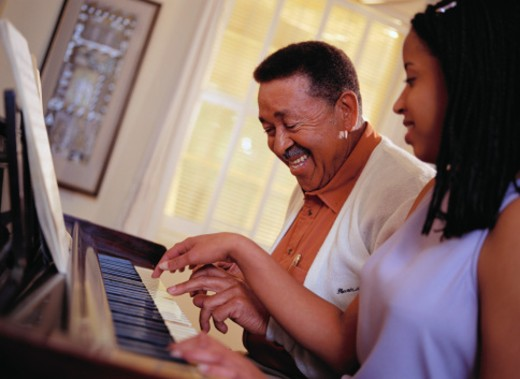 Grandfather and Granddaughter at Piano : Stock Photo