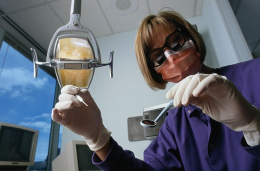 Stock Photo: 1598R-122064 Dental Hygienist with Dental Instruments
