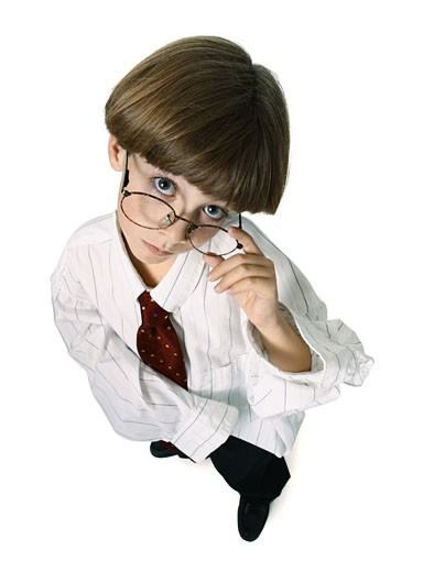 Stock Photo: 1598R-124256 a caucasian male child dresses up in a shirt and tie and glasses and glares up at the camera
