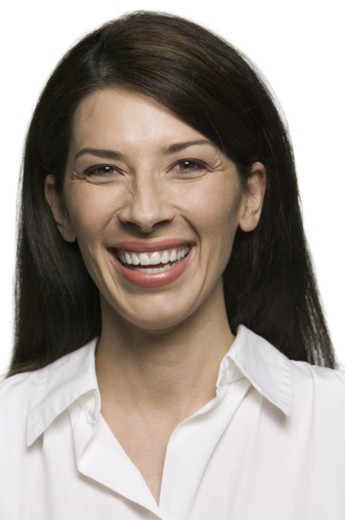 Stock Photo: 1598R-124531 portrait of an attractive adult brunette woman as she smiles brightly at the camera