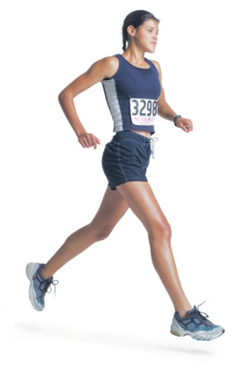 a young ethnic woman in a blue track uniform is wearing a marathon number and running : Stock Photo