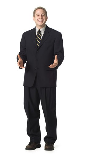 Stock Photo: 1598R-124955 a caucasian business man in a dark suit gestures with his hands and laughs slightly