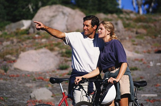 Stock Photo: 1598R-125990 Man and Woman Mountain Biking