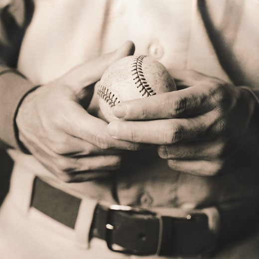 Close-Up of Baseball in Hands : Stock Photo