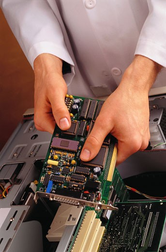 Installing Circuit Board : Stock Photo