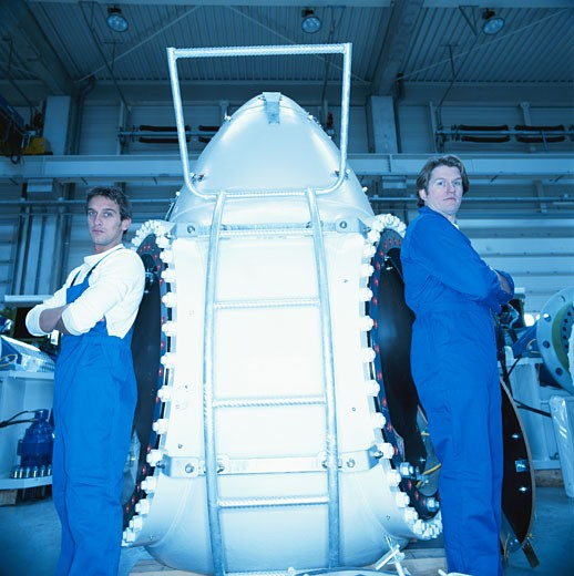 Two engineers standing in uniform : Stock Photo
