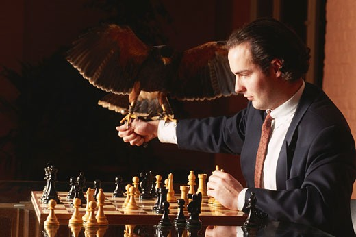 Stock Photo: 1598R-130390 Business man holding falloon chess board