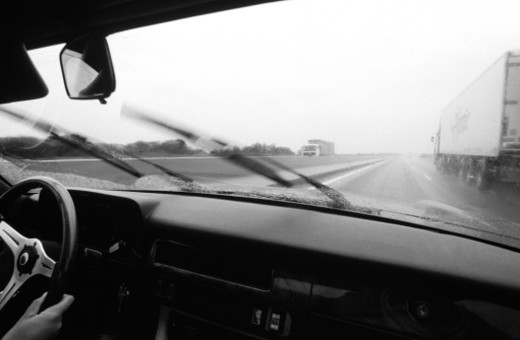 View from inside car driving on motorway, (B&W) : Stock Photo